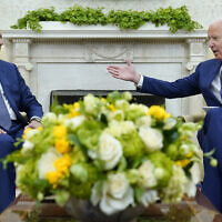 US President Joe Biden, right, speaks as Iraqi Prime Minister Mustafa al-Kadhimi, left, listens during their meeting in the Oval Office of the White House in Washington, July 26, 2021. (AP Photo/Susan Walsh)