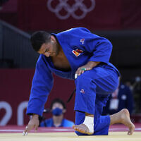 Iranian defector Saeid Mollaei, competing under a Mongolian flag, reacts after losing to Takanori Nagase of Japan, unseen, during the men -81kg final of the judo match at the 2020 Summer Olympics in Tokyo, Japan, July 27, 2021. (AP Photo/Vincent Thian)