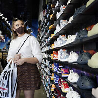 In this July 19, 2021, file photo, shoppers wear masks inside of The Cool store in the Fairfax district of Los Angeles. (AP Photo/Marcio Jose Sanchez)