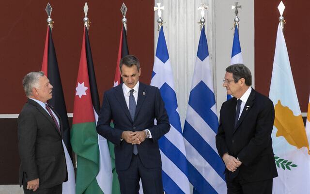 Jordan's King Abdullah II, left, Greece's Prime Minister Kyriakos Mitsotakis, center, and Cyprus' President Nikos Anastasiades pose for a group photo ahead of their meeting in Athens, July 28, 2021. (AP Photo/Yorgos Karahalis)