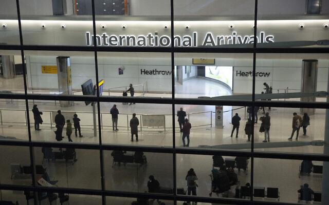 In this January 26, 2021 photo, people in the International Arrivals area at Heathrow Airport in London, during England's coronavirus lockdown. (AP/Matt Dunham)