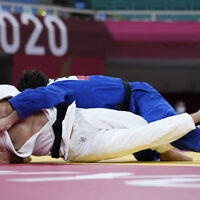 Peter Paltchik of Israel, left, and Aaron Wolf of Japan compete in the men's -100kg quarterfinal round judo match of the 2020 Summer Olympics in Tokyo, Japan, July 29, 2021. (AP/Vincent Thian)