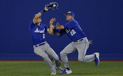 Israel's Mitchell Glasser (22) collides with teammate Blake Gailen as he catches a fly out hit by South Korea's Jaeil Oh during a baseball game at the 2020 Summer Olympics, July 29, 2021, in Yokohama, Japan. (AP Photo/Sue Ogrocki)