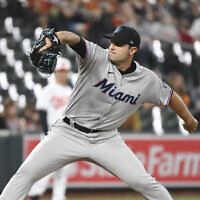 Miami Marlins relief pitcher Richard Bleier throws a pitch during the eighth inning of a baseball game against the Baltimore Orioles Wednesday, on July 28, 2021, in Baltimore. (AP Photo/Terrance Williams)