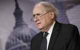 Then-Senator Carl Levin of Michigan attends a news conference at the Capitol in Washington,  December 4, 2014. (AP Photo/J. Scott Applewhite, File)