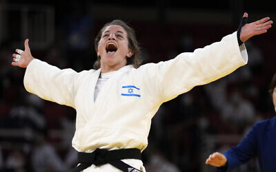 Timna Nelson-Levy of Israel reacts after defeating Daria Mezhetskaia of the Russian Olympic Committee in their bronze medal match in team judo competition at the 2020 Summer Olympics, on July 31, 2021, in Tokyo, Japan. (AP Photo/Vincent Thian)