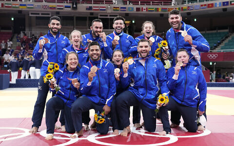 Members of Israel's team pose with their bronze medals after the medal ceremony in team judo competition at the 2020 Summer Olympics,  July 31, 2021, in Tokyo, Japan. (AP Photo/Vincent Thian)