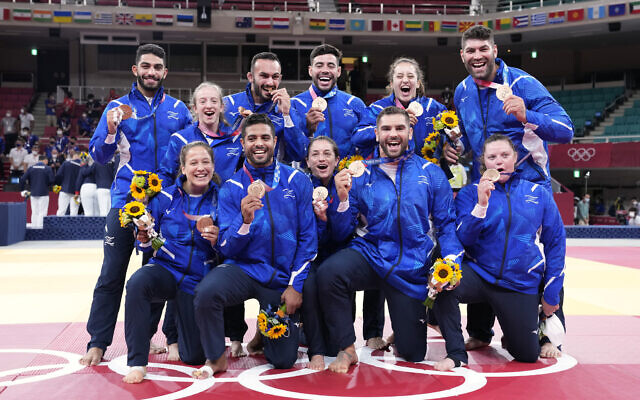 Members of Israel's team pose with their bronze medals after the medal ceremony in team judo competition at the 2020 Summer Olympics, on July 31, 2021, in Tokyo, Japan. (AP Photo/Vincent Thian)