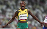 Elaine Thompson-Herah of Jamaica wins the women's 100-meter final at the 2020 Summer Olympics, July 31, 2021, in Tokyo. (AP Photo/Martin Meissner)