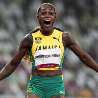 Elaine Thompson-Herah of Jamaica wins the women's 100-meter final at the 2020 Summer Olympics, on July 31, 2021, in Tokyo. (AP Photo/Martin Meissner)