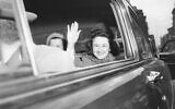 Ethel Rosenberg smiles and waves as she leaves New York's Women's detention home in an automobile for the death house in Sing Sing Prison April 11, 1951. The 35-year-old Mrs. Rosenberg and her husband, Julius, 32, were sentenced to die for furnishing wartime atom secrets to a soviet spy ring. (AP Photo/Murray Becker)