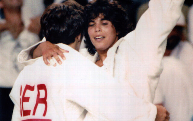 Israeli Olympic judo athlete Yael Arad, right, celebrates and hugs her German opponent, Frauke Eickoff, after winning the semi-final match at the Barcelona  Olympics, on July 30, 1992. (AP Photo)