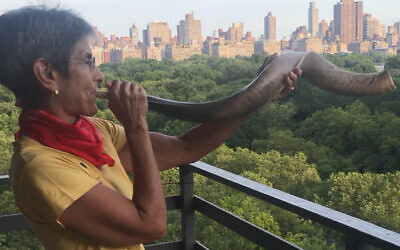 Since the early days of the pandemic, Rabbi Janise Poticha has kept up her shofar-blowing at 7 p.m. daily as a salute to health care workers. (Lydia Orias/via JTA)