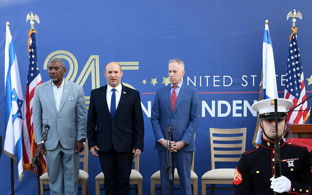 US House Foreign Affairs Committee chairman Gregory Meeks, Prime Minister Naftali Bennett and US Embassy in Israel Charge D'affaires Michael Ratney at the US Embassy's Independence Day celebration on July 5, 2021. (Ziv Sokolov/US Embassy in Jerusalem)
