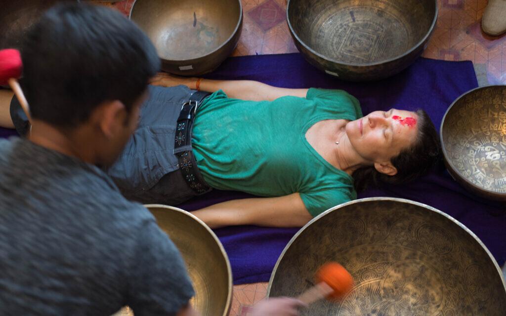 Deborah Copaken undergoing sound bowl therapy in Kathmandu, July 2017 (Stephen Douglas Alexander)