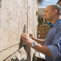 Current Prime Minister Naftali Bennett prays at the Western Wall in Jerusalem's Old City on March 16, 2015. (Yonatan Sindel/Flash90)