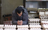 A man selling eggs at an eggstand in the Machane Yehuda Market, in Jerusalem, January 27, 2018. (Liba Farkash/ Flash 90)