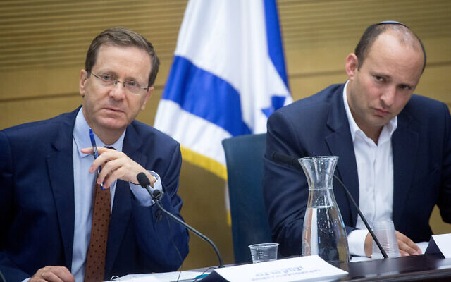 Isaac Herzog (L) and Naftali Bennett at the Knesset in June 2018. (Miriam Alster/Flash90)