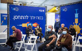 Israelis wait to recieve a COVID-19 vaccine, at a vaccination center operated by the Tel Aviv Municipality with Tel Aviv Sourasky Medical Center (Ichilov), at Rabin Square in Tel Aviv, December 31, 2020. (Miriam ALster/Flash90)