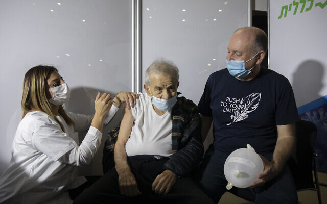 Illustrative: An elderly man receives a COVID-19 vaccine at the Clalit vaccination center in Jerusalem, on January 4, 2021. (Olivier Fitoussi/Flash90)