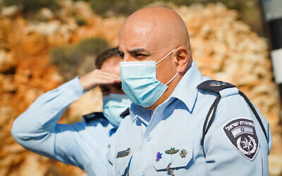 Moshe Barkat, then commander of the police Judea and Samaria district, visits a temporary roadblock in the Sha'ar Binyamin industrial zone in the West Bank, January 10, 2021. (Hillel Meir/Flash90)