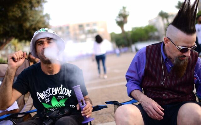 Israelis gather at Rabin Square in Tel Aviv to mark the international marijuana smoking day, in a demonstration to legalize the drug, on April 20, 2021. (Tomer Neuberg/Flash90)