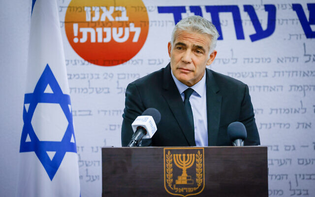 Foreign Minister and Yesh Atid leader Yair Lapid speaks during a faction meeting at the Knesset, on July 5, 2021. (Olivier Fitoussi/Flash90)
