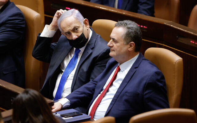Then-prime minister Benjamin Netanyahu and then-finance minister Israel Katz attend the swearing in of the new government, at the Knesset in Jerusalem, on June 13, 2021. (Olivier Fitoussi/Flash90)