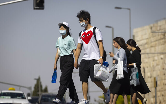 People. some with face masks. in Jerusalem on June 29, 2021. (Olivier Fitoussi/Flash90)