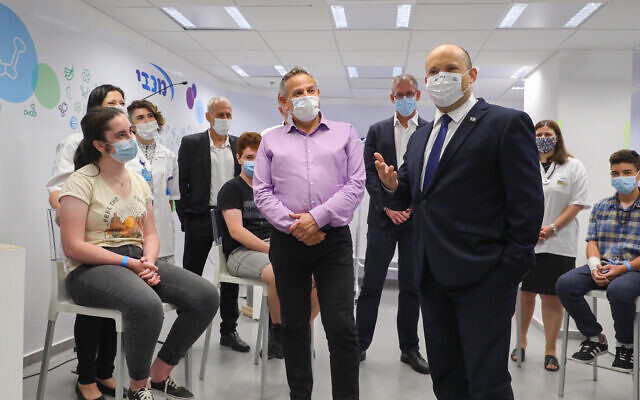 Prime Minister Naftali Bennet and Health Minister Nitzan Horowitz attend a press conference at a Maccabi vaccine center in Holon on June 29 2021. (Marc Israel Sellem/POOL via Flash90)