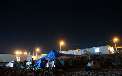 Settlers at the seen at the illegal outpost of Evyatar in the West Bank on June 29, 2021. (Sraya Diamant/Flash90)