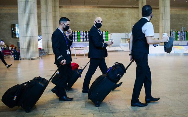 Flight staff are seen in the arrival hall of Ben Gurion International Airport, on June 30, 2021. (Avshalom Sassoni/Flash90)
