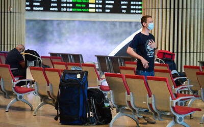 Travelers are seen in the arrival hall of Ben Gurion International Airport, on June 30, 2021. (Avshalom Sassoni/Flash90)