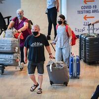 Travelers at Ben Gurion International Airport, on June 30, 2021, heading for COVID-19 tests. (Avshalom Sassoni/Flash90)