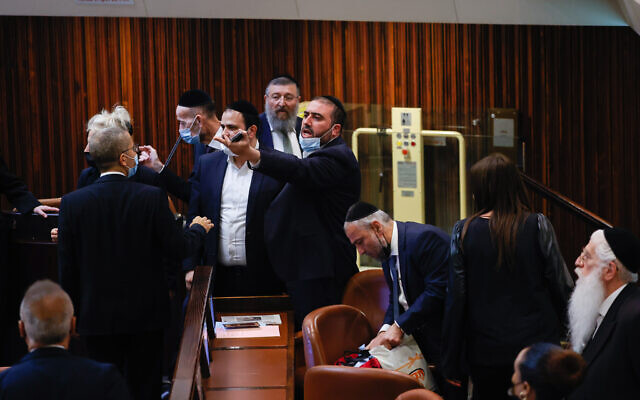 Members of the opposition argue during a discussion on a law regarding unemployment payouts during a plenum session in the Knesset in Jerusalem on July 1, 2021. (Yonatan Sindel/FLASH90)