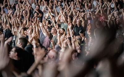 The crowd cheering during a concert in Raanana, on June 12, 2021 (Yahav Gamliel/Flash90)