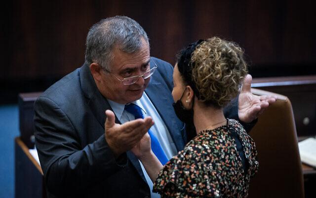 Likud MK David Bitan (L) speaks with coalition whip Idit Silman (Yamina) during a Knesset plenum session in Jerusalem, on July 6, 2021. (Yonatan Sindel/Flash90)