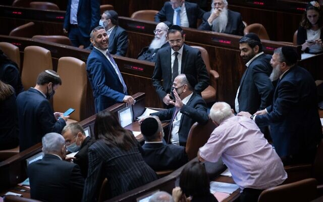 Opposition members rejoice after a Knesset vote rejected an extension of the Palestinian family reunification law, in Jerusalem, on July 6, 2021. (Yonatan Sindel/Flash90)