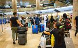 Travelers arriving at Ben Gurion Airport on July 1, 2021. (Nati Shohat/Flash90)