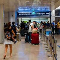 Travelers stand in line to get coronavirus checks upon  arriving at Israel's Ben Gurion Airport, July 1, 2021. (Nati Shohat/ Flash90)