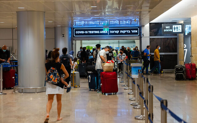 Travelers at Ben Gurion International Airport, on June 30, 2021, heading for COVID-19 tests. (Nati Shohat/FLASH90)