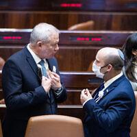 Defense Minister Benny Gantz (L) and Prime Minister Naftali Bennett speak during the swearing-in ceremony for new President Isaac Herzog on July 7, 2021. (Yonatan Sindel/Flash90)