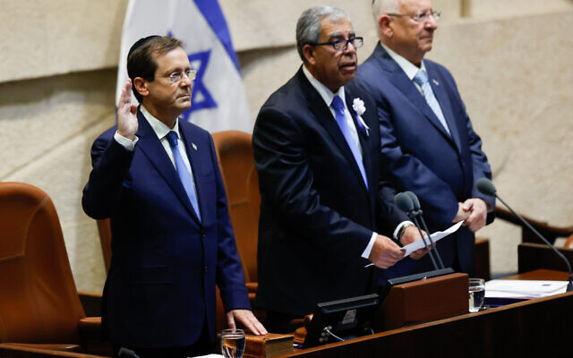 President Isaac Herzog (L) is sworn in at the Knesset in Jerusalem on July 7, 2021. To his right are Knesset Speaker Mickey Levy and outgoing President Reuven Rivlin. (Yonatan Sindel/Flash90)