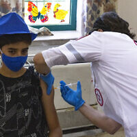 Israeli youth receive COVID-19 vaccine injections at a vaccination center in Jerusalem, July 8, 2021. (Olivier Fitoussi/Flash90)