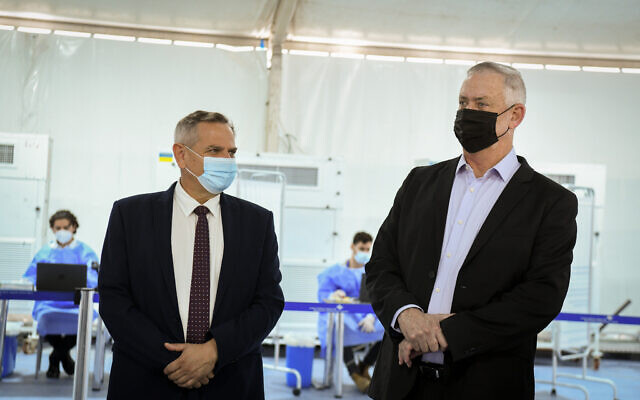 Defense Minister Benny Gantz, right, and Health Minister Nitzan Horowitz visit a tent for Covid-19 testing for incoming passengers at Ben Gurion International Airport near Tel Aviv on July 12, 2021. (Flash90)