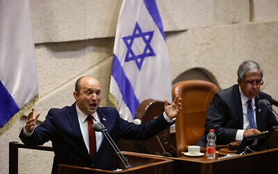 Prime Minister Naftali Bennett speaks during a plenum session in the Knesset on July 12, 2021. (Olivier Fitoussi/Flash90)