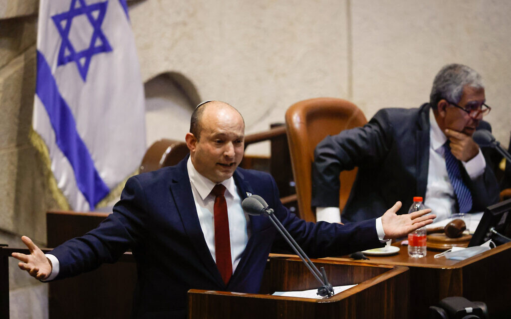 Prime Minister Naftali Bennett speaks during a plenum session in the assembly hall of the Israeli parliament, on July 12, 2021. (Olivier Fitoussi/Flash90)