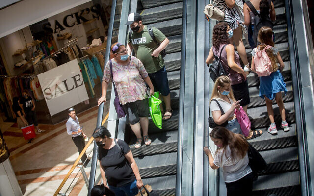 People wear protective face masks as they shop at Azrieli Mall in Tel Aviv on July 13, 2021. (Miriam Alster/FLASH90)