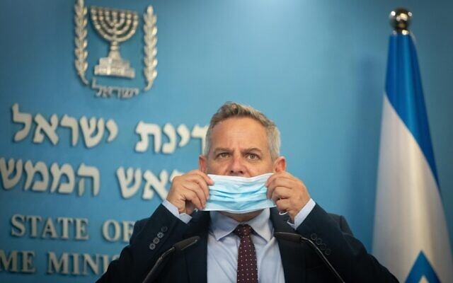 Health Minister Nitzan Horowitz holds a press conference, together with Prime Minister Naftali Bennett (not seen) at the Prime Minister's Office in Jerusalem on July 14, 2021. (Noam Revkin Fenton/FLASH90)