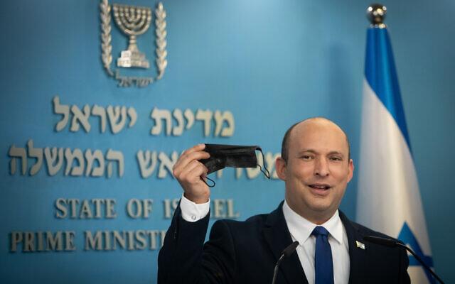 Prime Minister Naftali Bennett holds a press conference at his office in Jerusalem, on July 14, 2021. (Noam Revkin Fenton/Flash90)